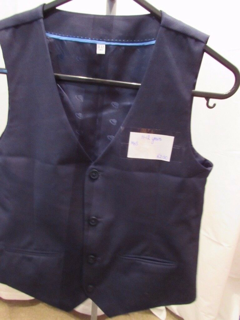 Age 11-12 boys navy waistcoat from M&S. Worn 1 for a school trip so in excellent condition. P&SF