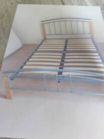 "DOUBLE SLATTED SPRUNG BED 4'6"" WOOD AND SILVER METAL. EXCELLENT condition. Ready to go dismantled."