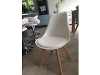 Four white tulip chairs