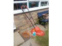 Hover Lawn Mower. Excellent condition with spare blades