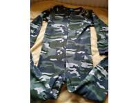 Green onesie size 11-12years