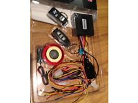Motorcycle alarm system with remote control