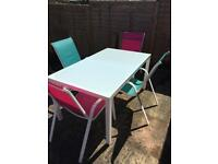 Garden table and 4 chairs. Great condition!!