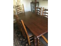 Solid oak dining table & chairs.