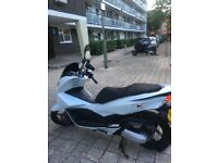 SCOOTER 125cc HONDA WW PCX125 for sale, with hood, locker and cover INCLUDED