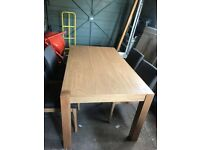 Oak dining table and chairs very little use