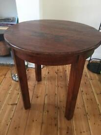 Solid round table - dark wood - perfect corner table