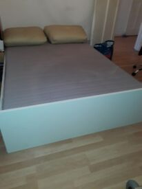 White solid wood frame double bed with roll-up mattress