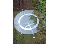 USED: circular glass-topped coffee table with attractive metal base. £15 London SE18 2DA
