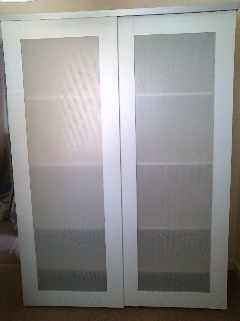 white ikea elga wardrobe with aneboda sliding door in east leake