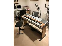 Yamaha DGX 630 Digital Piano with pedal board