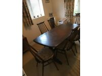 Ercol dining table and 6 Goldsmiths chairs