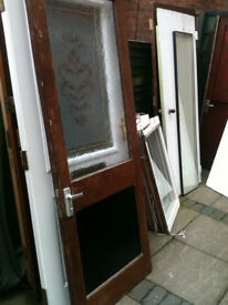 Exterior wooden door with frosted glass panel