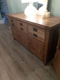 For sale solid oak sideboard and soft Italian leather footstool.