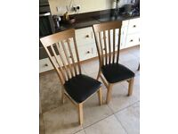 Strong smart high-back dining chairs, £18 each or £35 for both