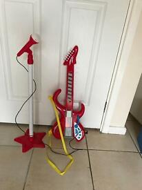 Guitar stand and microphone