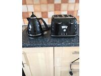 Black delonghi brilliante kettle and toaster.