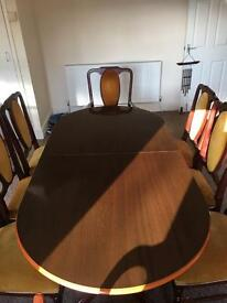 Elegant extending dinning table & eight chairs