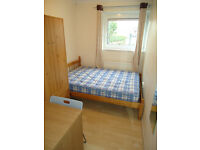 Double room for single person available in clean house, 5min walk to Barons Court Station