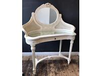 White dressing table with mirrored top.