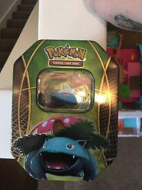 Pokémon tin with EX