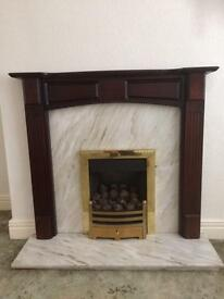 Wood fire surround, marble hearth and back plate plus gas fire, all excellent condition £60 only.
