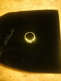 18 carat gold 2 stone diamond ring with a cross over