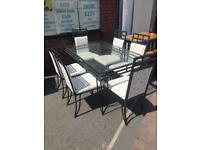Quality Glass dining table and 6 chairs