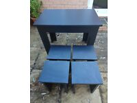 SPACE SAVING TABLE AND CHAIRS . HARDLY USED VERY GOOD CONDITION .