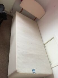 Single bed divan base and cream headboard.