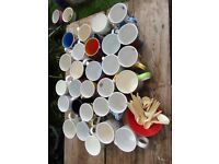 A collection of china drinking mugs ideal for events.