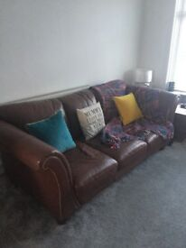 Brown leather Chesterfield style sofa and armchair