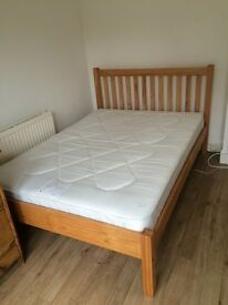 John Lewis solid wood double bed frame. Excellent condition.