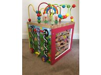 Wooden activity cube; Five sides to play