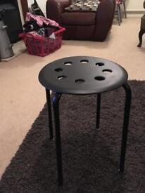 IKEA plastic stool, used in salon.