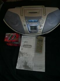 panasonic CD/Radio/Tape comes with remote instruction book/ 10 new tapes
