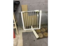 Two pressure fit stair gates- one with extension