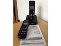 Panasonic cordless phone with spare handset and operating instructions