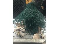 Roll of green coated mesh fencing wire, unused