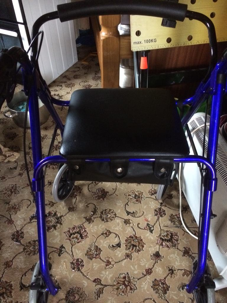 Walker/ stroller with seat and storage