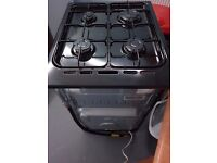 New world cooker GTC50, black. Mint condition. Separate oven and grill. Safety cut off.