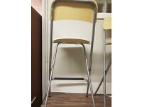 Used twice bar stools theh also fold