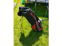 Golf bag with wheels and stand