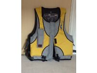 Life jacket with line cutting tool
