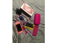 Nintendo switch lite coral with mariokart 8 and accessories