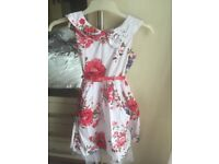 Girls white and floral red dress age 10