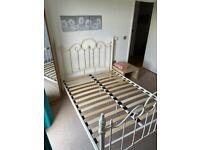 Cream double metal bed