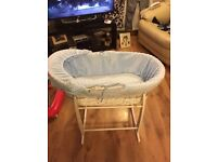 Blue Moses basket on rocking stand