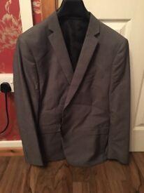 Mans grey suit