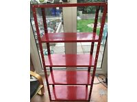 Red metal shelf unit